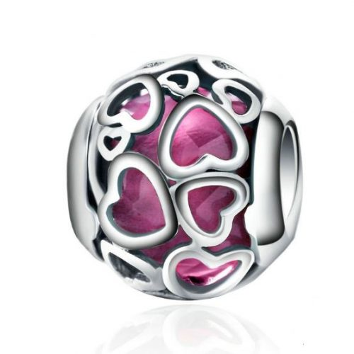 Stay surrounded by romance with the Cerise Encased in Love Charm by PANDORA. Faceted cerise crystal is surrounded by a sterling silver openwork heart design, making this the perfect gift for the one you love.